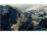 Splošna uganka brez prestanka! ...zadaj levo greben Rjavine,  pred Rjavino Begunjski vrh, desno od njega Vzhodne Glave...