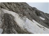 Na Triglav?... kar je še snega pred vstopom v steno; za koga je lahko malo sitno, ker je ledeno in strmo...